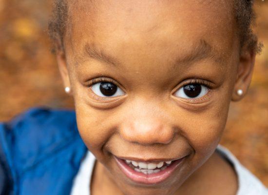 A smiling PreK student