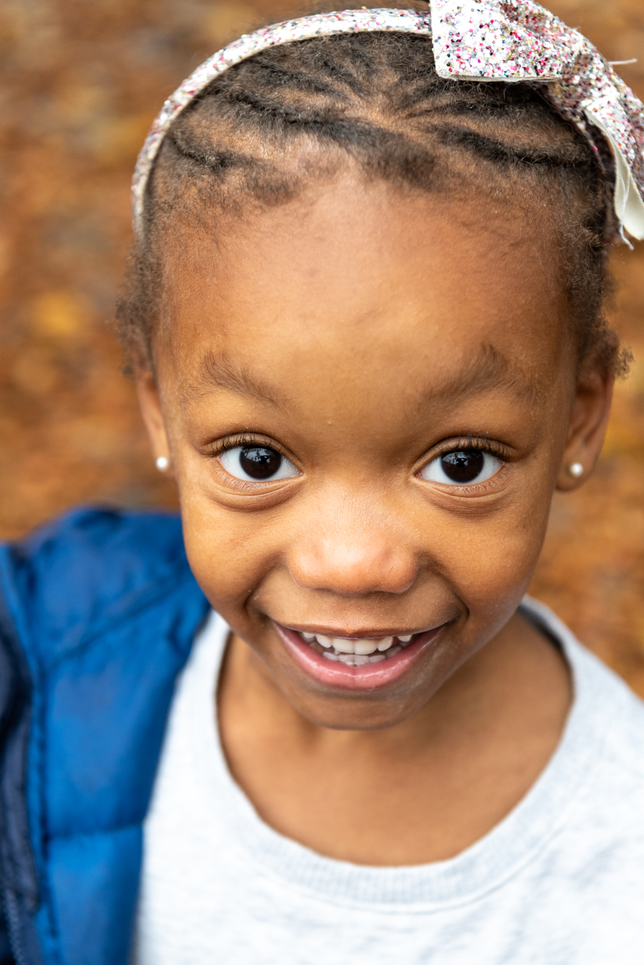 A smiling PreK student